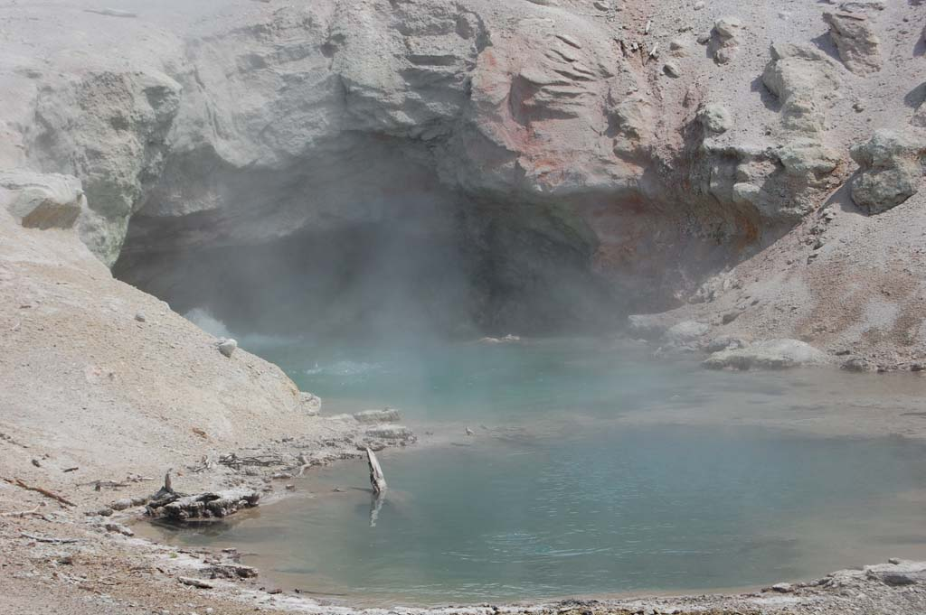 steam boiling from the mouth of a small cave in the Norris Geyser Basin