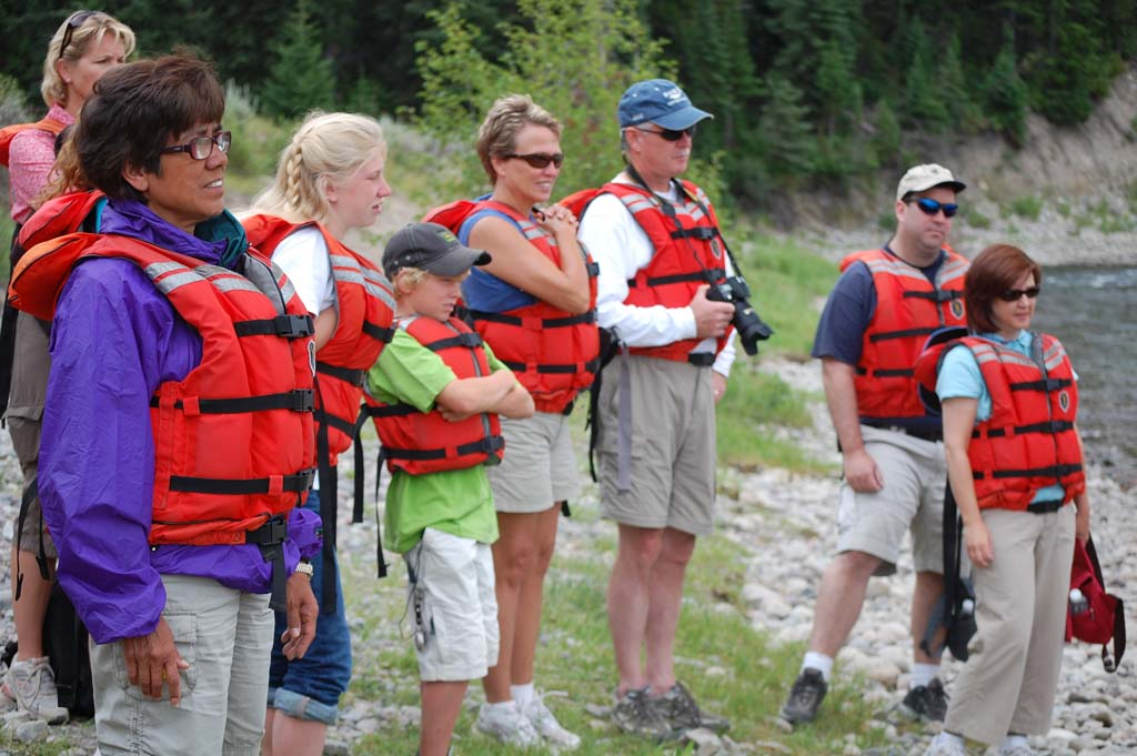 Tourists put on their flotation devices in preparation for their float trip down the Snake River