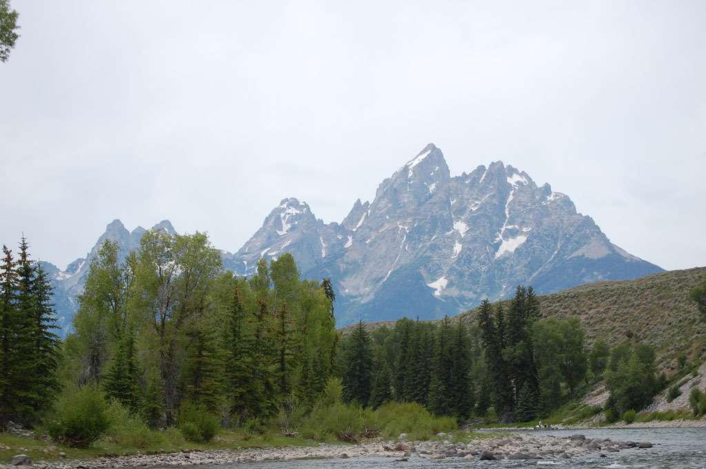 Pontoon boat floats down the Snake River in Grand Teton National Park